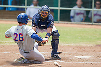 San Antonio Missions catcher Griff Erickson (11) tags Midland RockHounds baserunner Josh Whitaker (26) out at the plate during the Texas League baseball game on June 28, 2015 at Nelson Wolff Stadium in San Antonio, Texas. The Missions defeated the RockHounds 7-2. (Andrew Woolley/Four Seam Images)