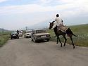 Armenia 2007 <br /> A Yezidi wedding in a village: the escort following the bride  on her way to the village of the bridegroom  <br /> Armenie 2007 <br /> Un mariage yezidi dans un village: l'escorte derriere la voiture de la mariée allant au village du marié