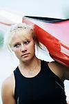 Young woman carrying kayak