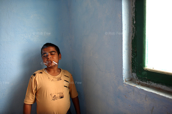 17-year-old Lorenzo, in Ablania's Vaqarr prison for his third heroin offence, acts tough for the camera. Seconds later, he giggles.