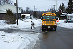 Student leaving school bus on winter day