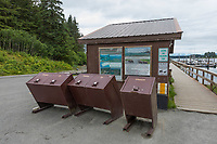 Bear proof trash cans in the parking lot of the harbor of Yakutat, Alaska.