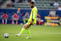 CARSON, CA - APRIL 25: Carlos Coronel #13 of New York Red Bulls passes off a ball during a game between New York Red Bulls and Los Angeles Galaxy at Dignity Health Sports Park on April 25, 2021 in Carson, California.