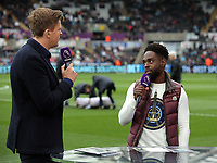 Nathan Dyer of Swansea City (R) is interviewed by Jake Humphrey for BT Sport during the Premier League match between Swansea City and Everton at The Liberty Stadium, Swansea, Wales, UK. Saturday 06 May 2017