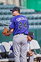Albuquerque Isotopes starting pitcher Chi Chi Gonzalez (24) before the game against the Salt Lake Bees at Smith's Ballpark on April 27, 2019 in Salt Lake City, Utah. The Isotopes defeated the Bees 10-7. This was a makeup game from April 26, 2019 that was cancelled due to rain. (Stephen Smith/Four Seam Images)