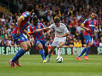 Pictured: Jason Puncheon of Crystal Palace (2nd L) challenges Jack Cork of Swansea<br /> Re: Premier League match between Crystal Palace and Swansea City at Selhurst Park on Sunday 24 May 2015 in London, England, UK