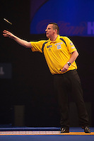 21.12.2014.  London, England.  William Hill World Darts Championship.  Dave Chisnall (8) [ENG] in action during his match with Ryan De Vreede [NED]. Chisnall won the match 3-0