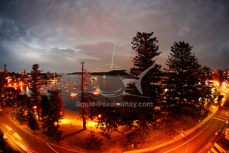 Sydney Harbour view from Manly on the North Shore by night.