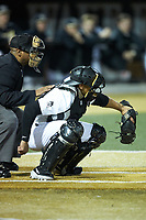Wake Forest Demon Deacons catcher Christian Long (19) frames a pitch as home plate umpire Gregory Street looks on during the game against the Sacred Heart Pioneers at David F. Couch Ballpark on February 15, 2019 in  Winston-Salem, North Carolina.  The Demon Deacons defeated the Pioneers 14-1. (Brian Westerholt/Four Seam Images)
