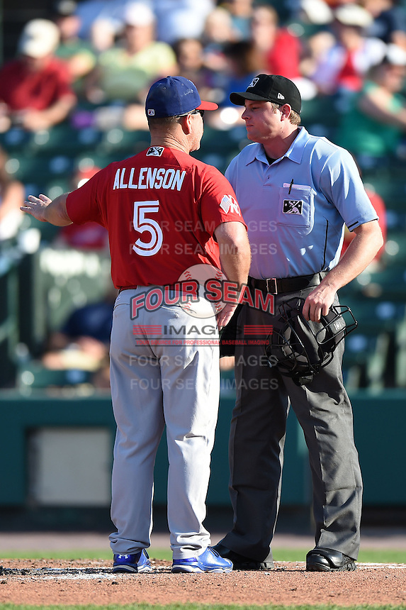 Umpire Joseph Born listens to an argument from manager Gary Allenson (5) during the second game of a doubleheader between the Buffalo Bisons Rochester Red Wings on July 6, 2014 at Frontier Field in Rochester, New  York.  Rochester defeated Buffalo 6-1.  (Mike Janes/Four Seam Images)