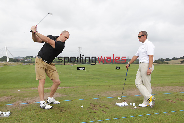 ISPS Handa Wales Open 2013<br /> Celtic Manor Resort<br /> Mike Tindall taking part in a golf teaching clinch organised by tournament sponsor ISPS Handa.<br /> <br /> 28.08.13<br /> <br /> ©Steve Pope-Sportingwales