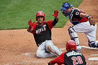 World Team Ketel Marte (7) slides home past catcher Kyle Schwarber (12) during the MLB All-Star Futures Game on July 12, 2015 at Great American Ball Park in Cincinnati, Ohio.  (Mike Janes/Four Seam Images)