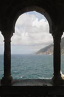 """- Portovenere (La Spezia), the coast towards the """"Cinque Terre"""" seen from under the arches of the S.Peter church..- Portovenere (La Spezia), la costa verso le Cinque Terre vista da sotto gli archi della chiesa di S.Pietro"""