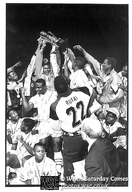 Nigeria 2 Zambia 1, 10/04/1994. Stade El Menzah, Tunis. African Cup of Nations final 1994, Tunisia.<br /> Goalkeeper Rufai and team mates celebrate with the trophy. Photo by Tony Davis