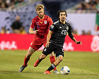 CHICAGO, IL - JULY 7: Tim Ream #13 defends Rodolfo Pizarro #20 during a game between Mexico and USMNT at Soldiers Field on July 7, 2019 in Chicago, Illinois.