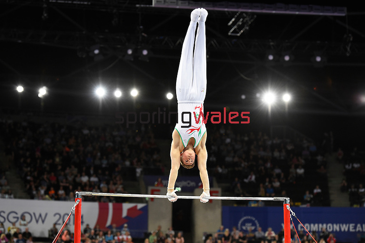 Wales' Robert Sansby during his routine on the horizontal bar in the WAG individual qualification and team final<br /> <br /> Photographer Chris Vaughan/SPORTINGWALES<br /> <br /> 20th Commonwealth Games - Day 6 - Tuesday 29th July 2014 - Gymnastics Artistic - The SSE Hydro - Glasgow - UK