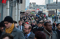 Members of the RMT & TSSA trade Unions go on strike over proposed cuts to station staff on London Underground. 5-2-14 Disruption on London Bridge as commuters walk into work in the City of London and wait for buses.