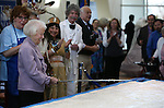 Kay Winters, 93, who worked on the centennial cake event 50 years ago, takes a turn cutting into the Sesquicentennial cake during the Battle Born Birthday Cake Celebration at the Carson Tahoe Regional Medical Center, in Carson City, Nev., on Friday, March 21, 2014. (Las Vegas Review-Journal/Cathleen Allison)