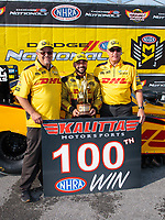 Sep 16, 2018; Mohnton, PA, USA; NHRA funny car driver J.R. Todd (center) celebrates with crew chief Jon Oberhofer (left) and Todd Smith after winning the Dodge Nationals at Maple Grove Raceway. Mandatory Credit: Mark J. Rebilas-USA TODAY Sports