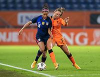 BREDA, NETHERLANDS - NOVEMBER 27: Margaret Purce #14 of the USWNT is tackled by Lieke Martens #11 of the Netherlands during a game between Netherlands and USWNT at Rat Verlegh Stadion on November 27, 2020 in Breda, Netherlands.