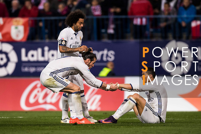 Cristiano Ronaldo of Real Madrid is helped up by teammate Gareth Bale during their La Liga match between Atletico de Madrid and Real Madrid at the Vicente Calderón Stadium on 19 November 2016 in Madrid, Spain. Photo by Diego Gonzalez Souto / Power Sport Images
