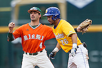 Miami Hurricanes second baseman Johnny Ruiz (4) waits for and UC Santa Barbara Gauchos baserunner Billy Fredrick (26) wait for the umpire to make a call during Game 5 of the NCAA College World Series on June 20, 2016 at TD Ameritrade Park in Omaha, Nebraska. UC Santa Barbara defeated Miami  5-3. (Andrew Woolley/Four Seam Images)