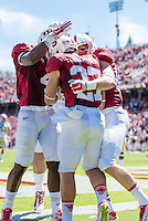STANFORD, CA - AUGUST 30, 2014:  Christian McCaffrey celebrates his touchdown with teammates during Stanford's game against UC Davis. The Cardinal defeated the Aggies 45-0.