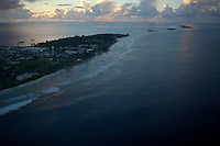 The U.S. Army base on Kwajalein, left, part of the Ronald Reagan Ballistic Missile Defense Test Site, is seen from the air over the Marshall Islands on June 12, 2012. The U.S. base has been used since 1946 as a staging ground for nuclear bomb tests conducted at Bikini Atoll and then as a range for inter-continental ballistic tests. Around one-thousand American defense contractors and U.S. military soldiers live on Kwajalein. The fourth island from the left is named Ebeye, and it is home to over 12,000 Marshallese people, living in an area of only 36 hectares of dry land. The Marshallese living here were pushed off many other islands to make room for U.S. missile and bomb testing activities.