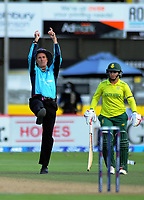 Umpire Billy Bowden indicates a six for South Africa captain Dane van Neikerk as Mignon du Preez (right) looks on during the International Women's Twenty20 Cricket match between the New Zealand White Ferns and South Africa Proteas at Basin Reserve in Wellington, New Zealand on Sunday, 9 February 2020. Photo: Dave Lintott / lintottphoto.co.nz