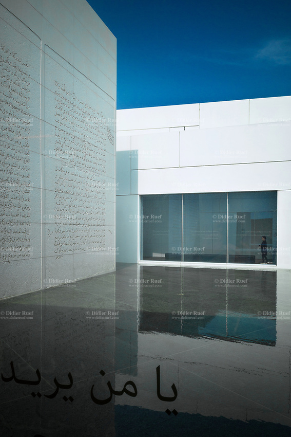 United Arab Emirates (UAE). Abu Dhabi.The Louvre Abu Dhabi is an art and civilization museum. The wall (L) was designed by the artist Jenny Holzer (born July 29, 1950 which is an American neo-conceptual artist. The main focus of her work is the delivery of words and ideas in public spaces. The arabic writings text is taken from the writings of Ibn Khaldun (27 May 1332 – 17 March 1406) who was an Arab scholar of Islam, social scientist and historian.He has been described as the father of the modern disciplines of historiography, sociology, economics, and demography. The museum is part of a thirty-year agreement between the city of Abu Dhabi and the French government. The Louvre Abu Dhabi museum is located on the Saadiyat Island Cultural District. It is approximately 24,000 square metres in size, with 8,000 square meters of galleries, making it the largest art museum in the Arabian peninsula. Jean Nouvel (born 12 August 1945), a French architect, has conceived the Louvre Abu Dhabi. Now considered as one of the modern urban wonders of the world, Louvre Abu Dhabi is not only the Arab world's first universal museum but a powerful symbol of the United Arab Emirates' ambition and achievement. The centre piece of Nouvel's vision is a huge silvery dome that appears to float above the museum-city. Despite its apparent weightlessness, the dome weighs around 7,500 tonnes. Inspired by the cupola, a distinctive feature in Arabic architecture, Nouvel's dome is a complex, geometric structure of 7,850 stars. These stars are repeated at various sizes and angles in eight different layers. As the sun passes above, its light filters through the perforations in the dome to create an enchanting effect within the museum, known as the 'rain of light'.  The United Arab Emirates (UAE) is a country in Western Asia at the northeast end of the Arabian Peninsula. 21.02.2020  © 2020 Didier Ruef