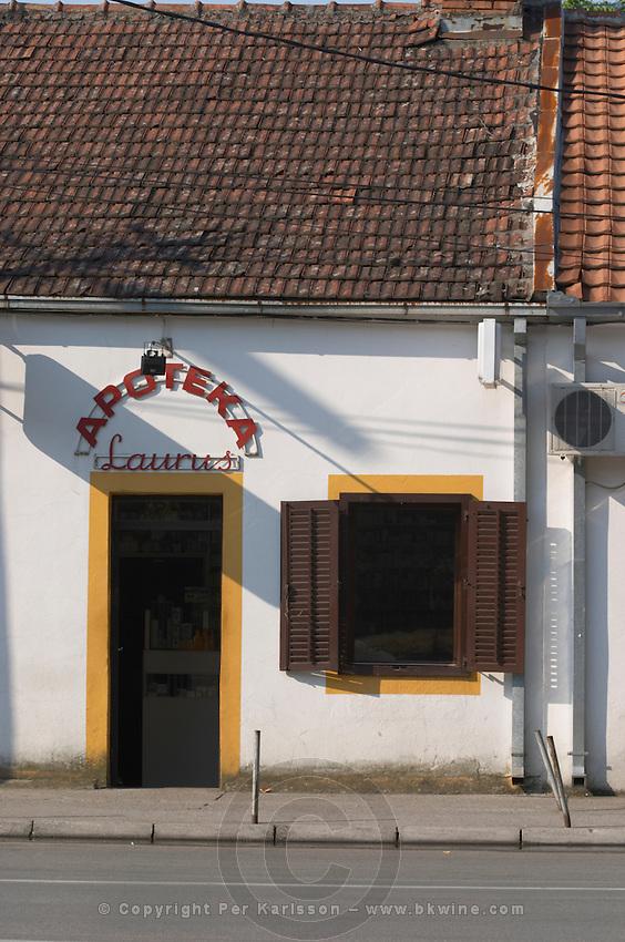 On the boulevard Ivana Cronjevica. A white building with a pharmacy, Apoteka Laurus. Podgorica capital. Montenegro, Balkan, Europe.