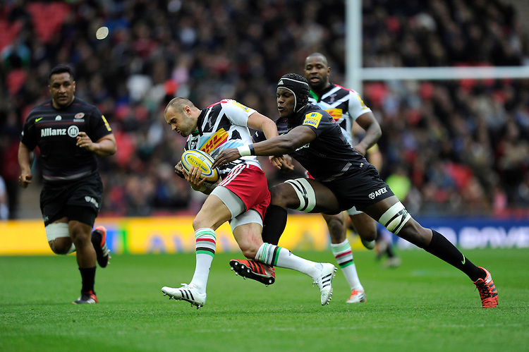 Ross Chisholm of Harlequins is tackled by Maro Itoje of Saracens