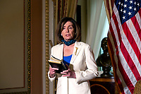 Speaker of the United States House of Representatives Nancy Pelosi (Democrat of California) holds the Bible following a bill enrollment ceremony for the Uyghur Human Rights Policy Act of 2020 at the Untied States Capitol in Washington D.C., U.S., on Tuesday, June 2, 2020.  On Monday, police used tear gas to clear protestors out of Lafayette Square so United States President Donald J. Trump could walk to Saint Johns Episcopal Church.  Credit: Stefani Reynolds / CNP/AdMedia