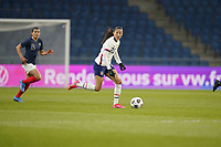LE HAVRE, FRANCE - APRIL 13: Christen Press #23 of the United States looks for an open man downfield during a game between France and USWNT at Stade Oceane on April 13, 2021 in Le Havre, France.