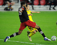 WASHINGTON, DC - OCTOBER 28: Donovan Pines #23 of D.C. United battles for the ball with Pedro Santos #7 of Columbus Crew SC during a game between Columbus Crew and D.C. United at Audi Field on October 28, 2020 in Washington, DC.