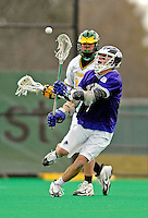 10 April 2007: Holy Cross Crusaders' Luke Marchand, a Sophomore from Concord, MA, in action against the University of Vermont Catamounts at Moulton Winder Field, in Burlington, Vermont. The Crusaders rallied to defeat the Catamounts 5-4...Mandatory Photo Credit: Ed Wolfstein Photo