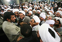 Iranian President Mahmoud Ahmadinejad greets religious figures after a meeting with them in Tehran. One of the principal parts of his provincial visits are gatherings with the local clergy, who are highly supportive, but also fiercely critical of the leader.