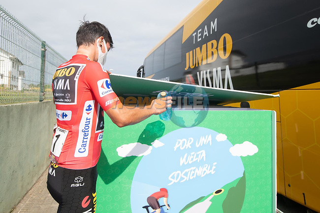 Red Jersey Primoz Roglic (SLO) Jumbo-Visma at the team bus before Stage 19 of La Vuelta d'Espana 2021, running 191.2km from Tapia de Casariego to Monforte de Lemos, Spain. 3rd September 2021.    <br /> Picture: Unipublic/Charly Lopez | Cyclefile<br /> <br /> All photos usage must carry mandatory copyright credit (© Cyclefile | Charly Lopez/Unipublic)