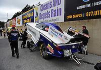 Oct. 2, 2011; Mohnton, PA, USA: NHRA crews member for funny car driver Leah Pruett during the Auto Plus Nationals at Maple Grove Raceway. Mandatory Credit: Mark J. Rebilas-