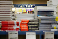 College textbooks for sale in a school bookstore.