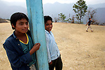 Native children stand outside their primary school in the village of Xaagundutia, in southern state of Guerrero. Photo by Heriberto Rodriguez
