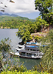 The Lembeh Resort's fleet of dive boats are moored in line In front of the Lembeh Resort, on Lembeh Island, off North Sulawesi, Indonesia.