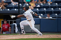 Frederick Cuevas (12) of the Scranton/Wilkes-Barre RailRiders follows through on his swing against the Rochester Red Wings at PNC Field on July 25, 2021 in Moosic, Pennsylvania. (Brian Westerholt/Four Seam Images)