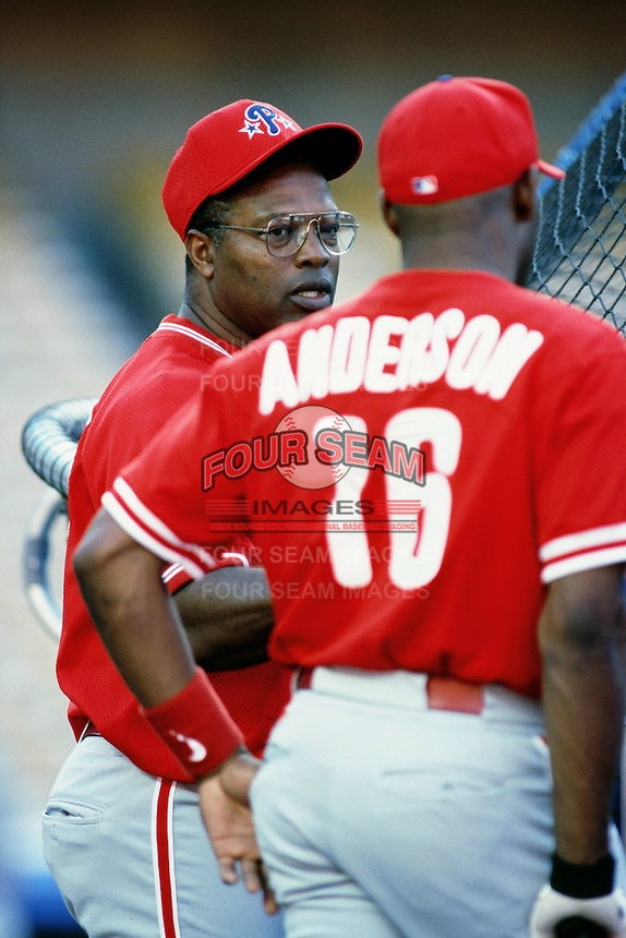 Philadelphia Phillies coach Hal McRae talks with Marlon Anderson before a game against the Los Angeles Dodgers at Dodger Stadium circa 1999 in Los Angeles, California. (Larry Goren/Four Seam Images)