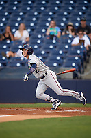 Fort Myers Miracle center fielder Casey Scoggins (32) follows through on a swing during a game against the Tampa Yankees on April 12, 2017 at George M. Steinbrenner Field in Tampa, Florida.  Tampa defeated Fort Myers 3-2.  (Mike Janes/Four Seam Images)