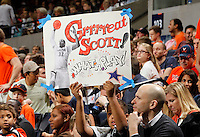 CHARLOTTESVILLE, VA- JANUARY 7: A Virginia Cavaliers fan holds up a sign for Mike Scott #23 of the Virginia Cavaliers during the game against the Miami Hurricanes on January 7, 2012 at the John Paul Jones Arena in Charlottesville, Virginia. Virginia defeated Miami 52-51. (Photo by Andrew Shurtleff/Getty Images) *** Local Caption *** Mike Scott