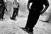 Culiacan, Mexico<br /> June 13, 2007<br /> <br /> A drug related execution, adding to the more then 300 this year in Cuilacan. Barely a skeleton remains from an obvious execution on the outskirts of the city. Forensic police established that it was a man of around 50 years of age.