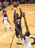 Jan. 2, 2011; Charlottesville, VA, USA;LSU Tigers forward Malcolm White (5) shoots over Virginia Cavaliers forward Akil Mitchell (25)  during the game at the John Paul Jones Arena. Virginia won 64-50. Mandatory Credit: Andrew Shurtleff-