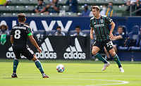 CARSON, CA - APRIL 25: Nick DePuy #20 of the Los Angeles Galaxy passes off the ball during a game between New York Red Bulls and Los Angeles Galaxy at Dignity Health Sports Park on April 25, 2021 in Carson, California.