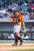 Norfolk Tides catcher Steve Clevenger (45) lets the infield know there are two outs during the game against the Charlotte Knights at BB&T BallPark on April 9, 2015 in Charlotte, North Carolina.  The Knights defeated the Tides 6-3.   (Brian Westerholt/Four Seam Images)